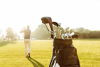 storyblocks-back-view-of-a-male-golfer-s