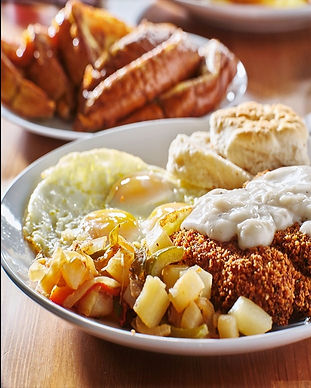 Big Breakfast as seen in this image of Country Fried Steak, Over Easy Eggs, & Pancake; can also be found to any visitors of Moose Cafe.  Moose Cafe serves spectacular breakfast sure to please any guests.  Sit down at Moose Cafe and have your table look like the one in the photograph