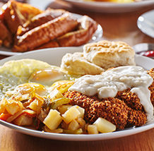 Buttermilk Fried Chicken Breakfast is a popular dish at the Moose Cafe.  Our Chicken is topped with white pepper gravy and served with farm fresh eggs and any breakfast side.  Visit Moose Cafe for breakfast 7 days a week for a fantastic meal 218x218