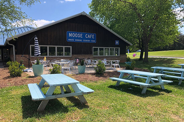 Enjoy Delicious Southern Cooking at Moose Cafe at the Piedmont Triad Farmers Market.  Open 7 Days a Week from 7am-4pm.  Guests enjoy Breakfast All Day and Tradional Southern Cooking Always Made From Scratch.Outdoor Dining Picnic Tables.jpg