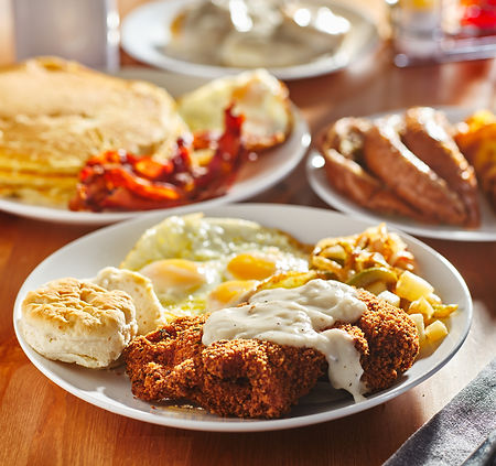 Big Breakfast as seen in this image of Country Fried Steak, Over Easy Eggs, & Pancake; can also be found to any visitors of Moose Cafe.  Moose Cafe serves spectacular breakfast sure to please any guests.  Sit down at Moose Cafe and have your table look like the one in the photograph 450x440.jpg