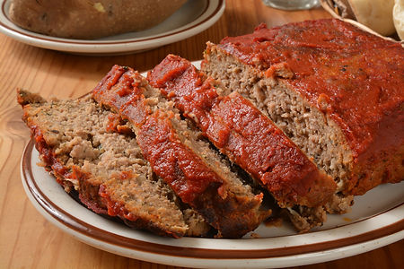 Savory Homemade Meatloaf Ready to Serve any hungry diner at Moose Cafe restaurant.  Homemade Meatloaf is the epitome of Southern Comfort Food and to no suprise is a specialty of award winning southern restaurant, Moose Cafe 450x440.jpg