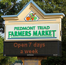 Farmers Market Sign.  Piedmont Triad Farmers Market Sign at the entrance on Sandy Ridge Rd.  Moose Cafe, located in the Piedmont Triad Farmers Market is open 7 days a week.  Moose Cafe is popular for breakfast and serving traditional southern classics.212x212.jpg