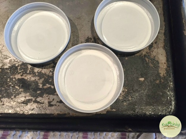 Cool jar lids after boiling upside down