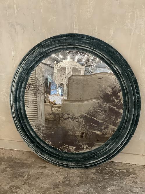 Round velvet covered mirror