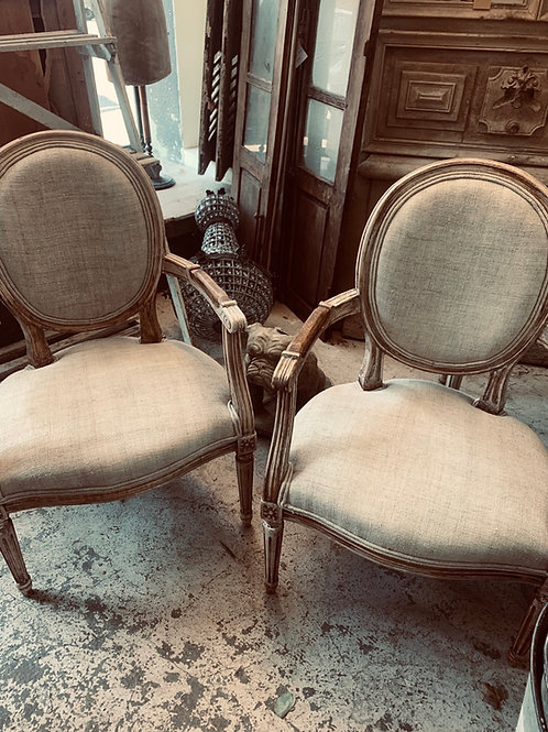 Beautiful pair of linen covered french chairs