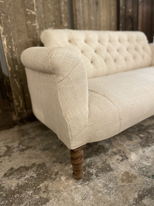 Beautiful button back sofa recovered in linen