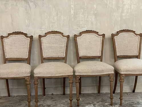 4 linen covered dining chairs