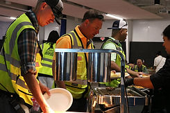 Refinery employees being served a hot catered lunch