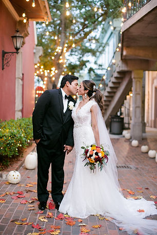 Bride and groom kiss outside in the breezeway of The Courtyard at Gaslight Square in Corpus Christi, Texas