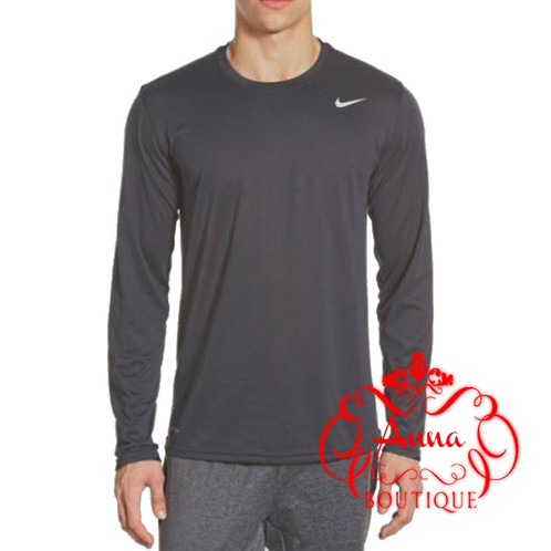 4ddd56a28b2d3b Lightweight, moisture-wicking Dri-FIT fabric keeps you dry and comfortable  in a workout-ready long-sleeve ...