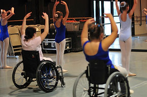Image of seated dance students in ballet class