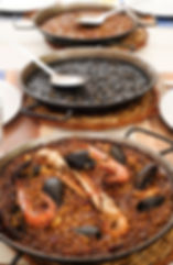 closeup of some paelleras, the paella pa