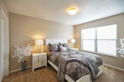the-township-apartment-homes-I-apartments-for-rent-kansas-city-mo-64155-master-bedroom.jpg
