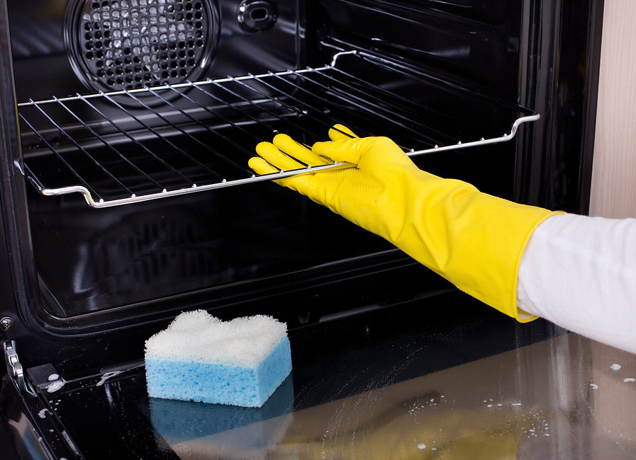 Canva - Woman cleaning oven.jpg