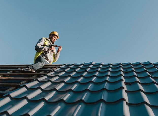 long-shot-man-working-on-roof_edited.jpg