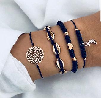 4 pc Black and Gold bracelet set