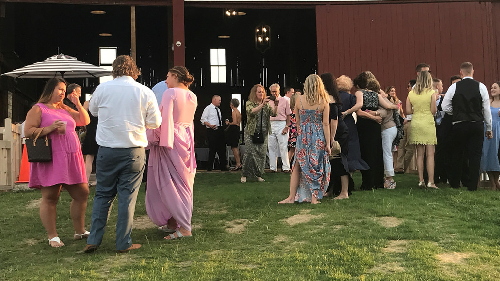 Cocktail hour before the wedding reception at Case Barlow Farm historic barn in Hudson, OH