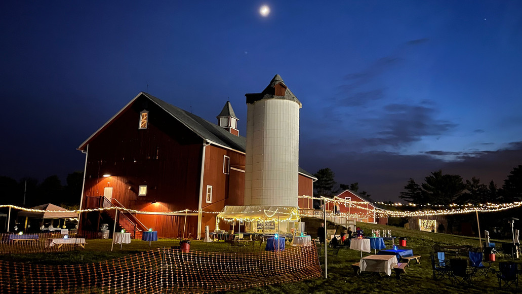 Outdoor food tents by the silo and outdoor dining tables
