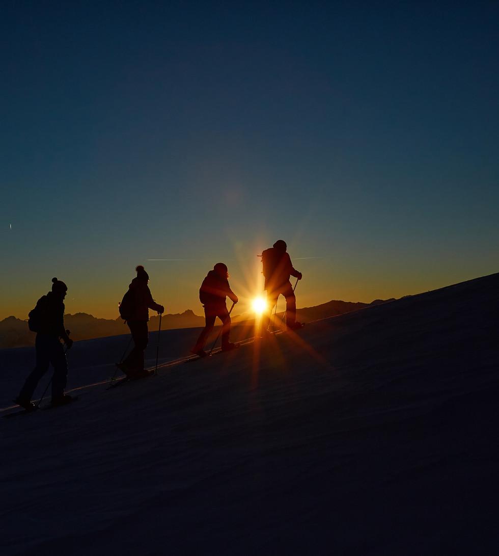 Sonnenuntergang mit Schneeschuhen