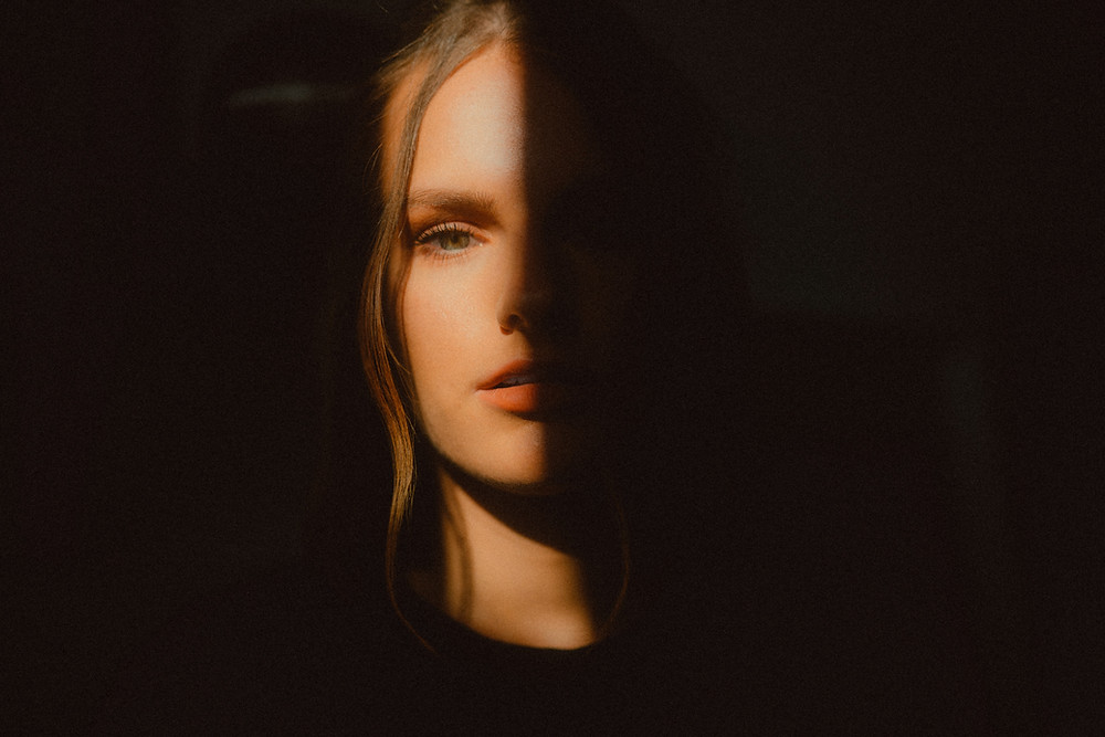 Woman with face half in shadow
