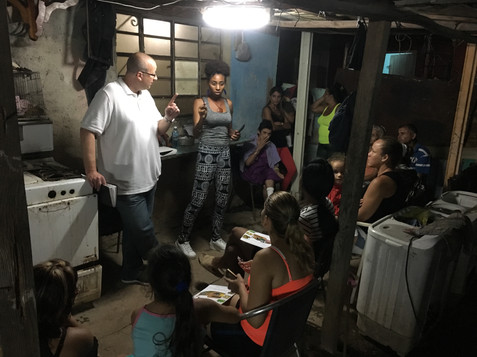 Brian and translator Eliani giving the message to a new house church