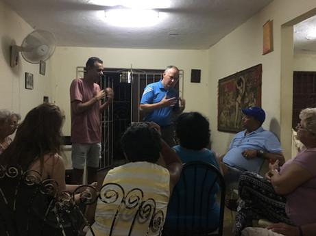 Steve teaching in a house church