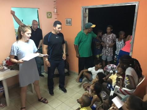 Emma teaching the kids at a house church