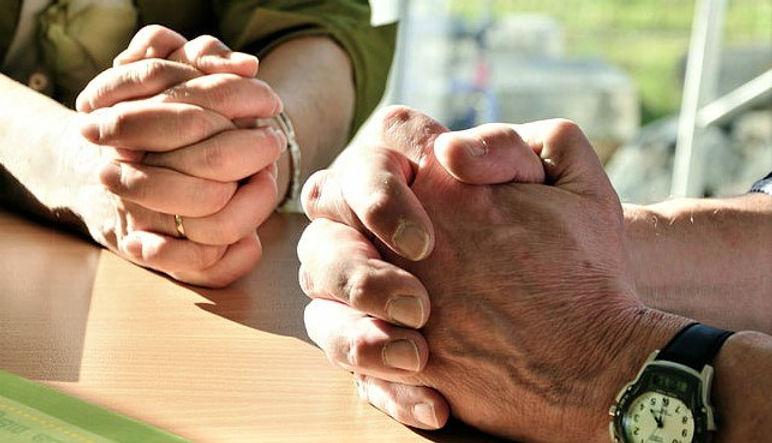 couple praying.jpg