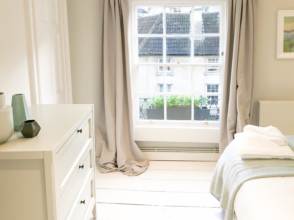 Bedroom One benefits from a large original sash window