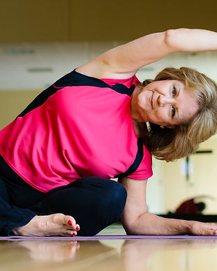 Mature Woman Does Yoga Side Bend.jpg
