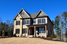 Customizable new construction home exterior on a sunny day