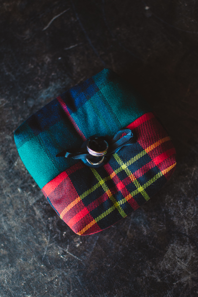 Scottish tartan ring cushion with the wedding rings attached