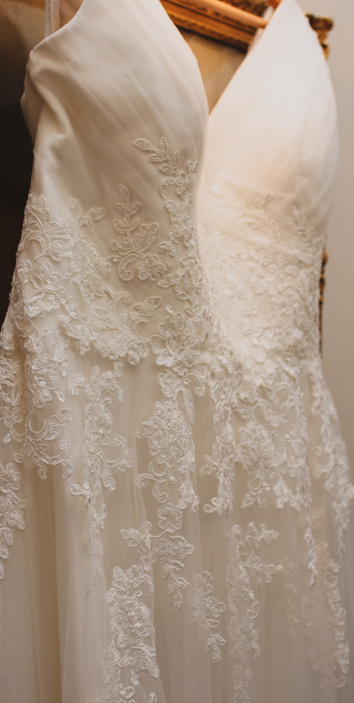 Detailed picture of the lace on the wedding dress before the bride put it on