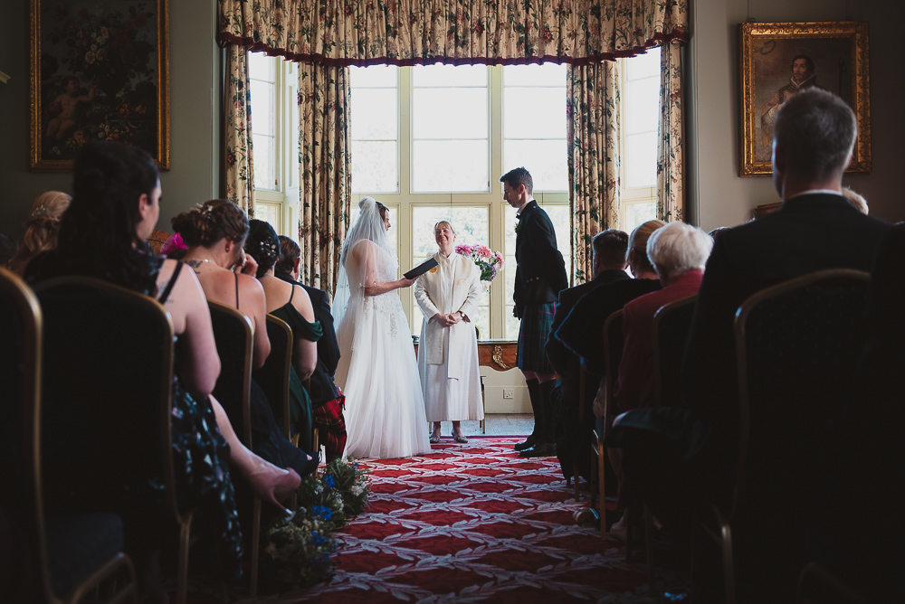 Bride reads her vows to the groom