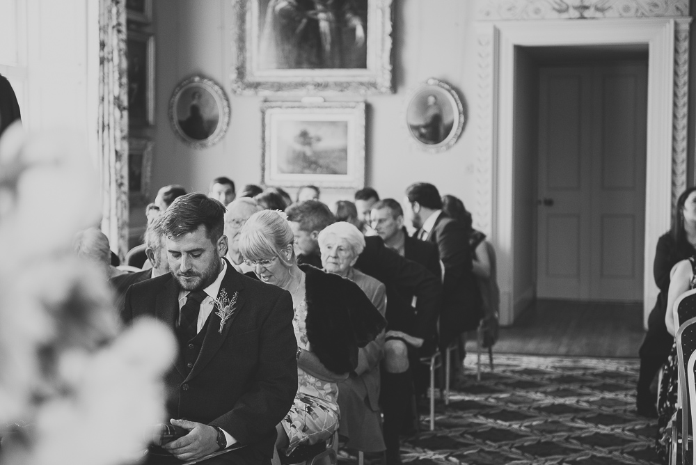Black and white image of guests waiting for the wedding ceremony to begin.