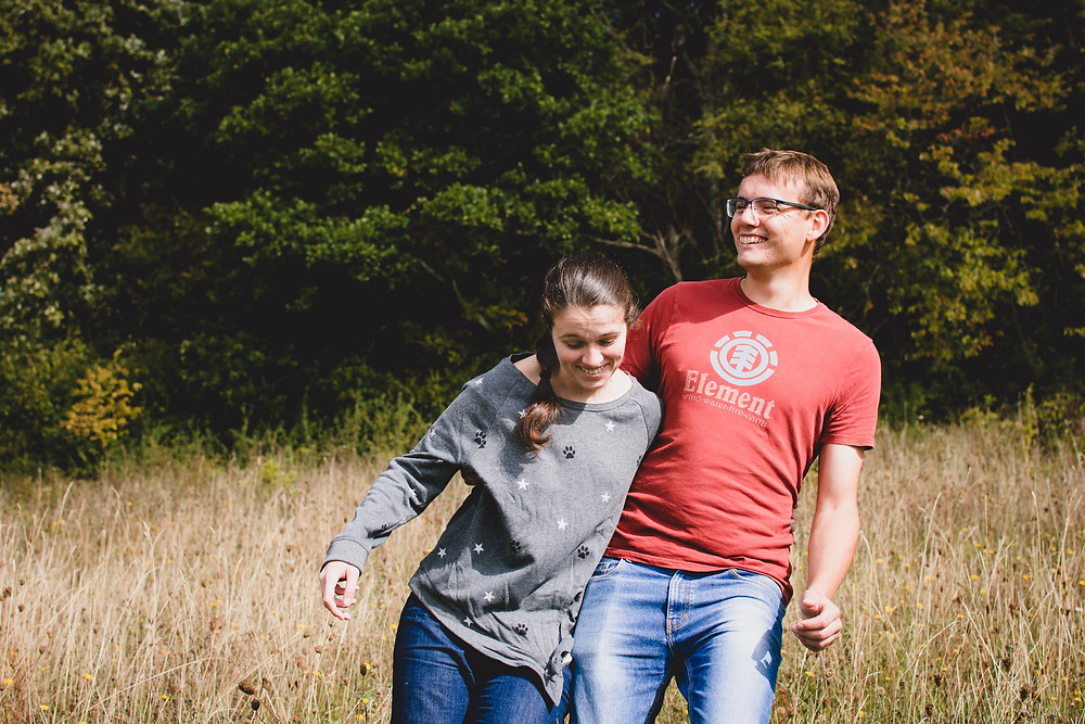 Couple laughing during engagement photoshoot outdoors