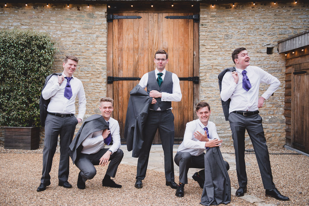 Groom and his ushers outside The Tythe Barn before the wedding ceremony