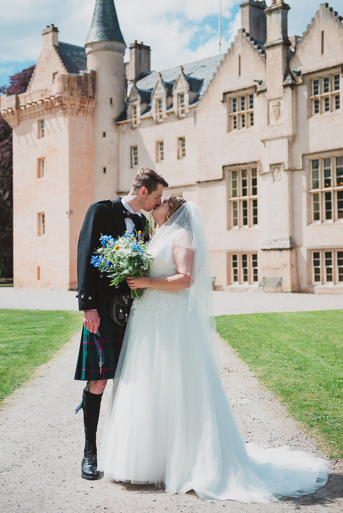 Romantic couple's photographs outside the castle on their wedding day
