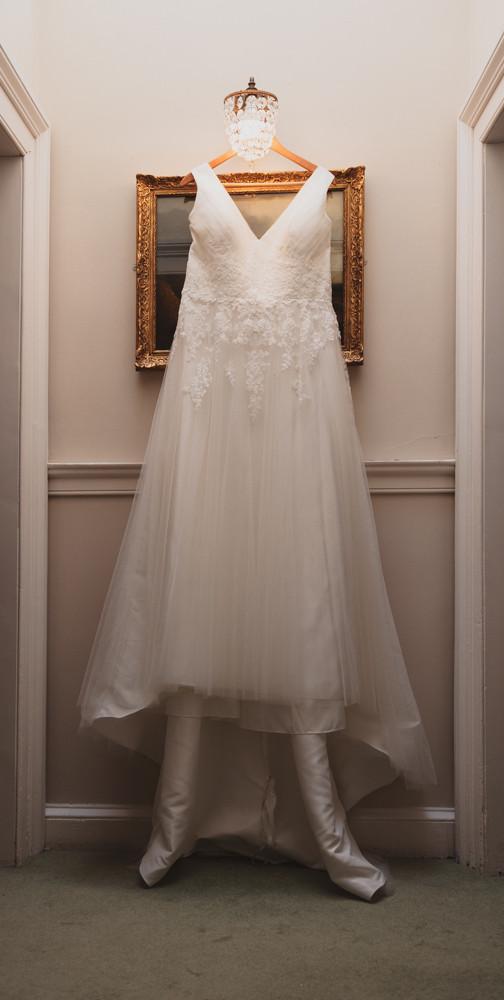 Wedding dress hanging up ready to be worn