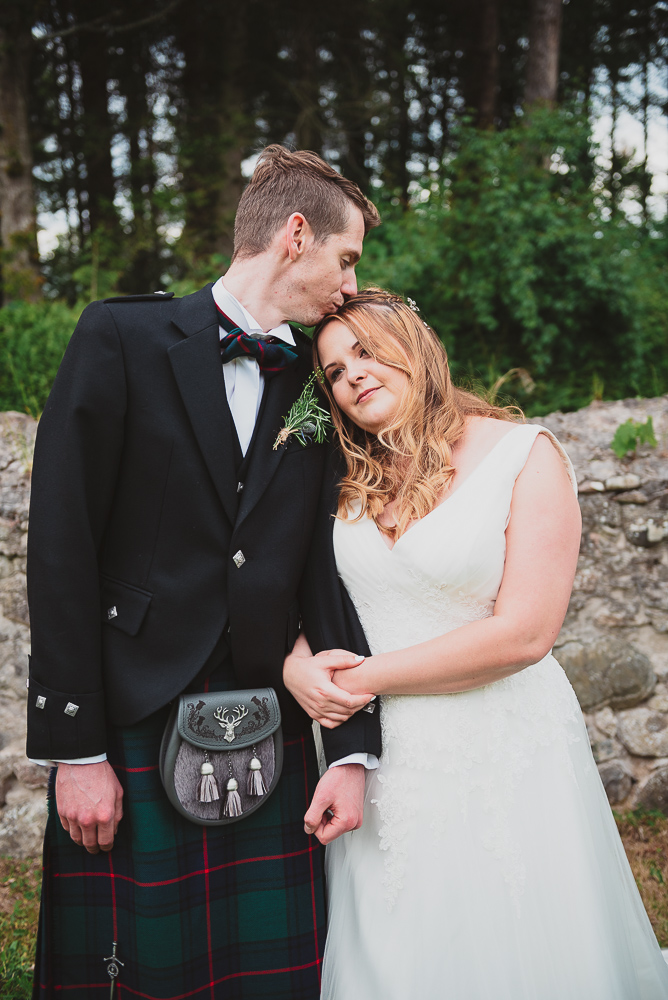 Romantic couple's photos in the castle grounds in Scotland.