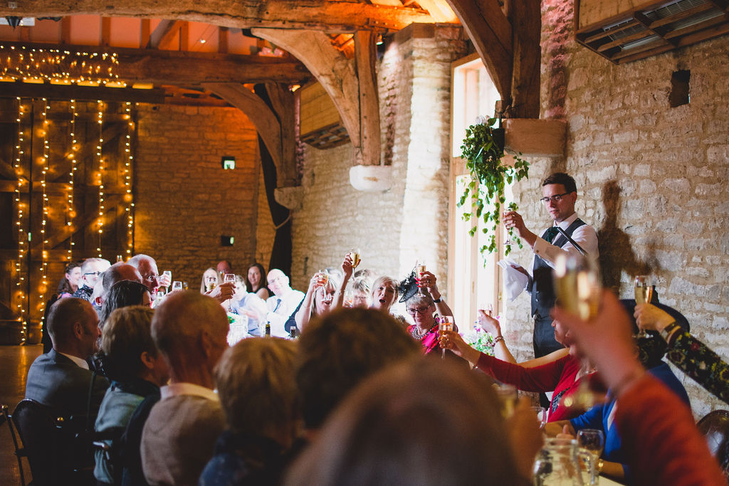 Groom raises a toast during the speeches at the wedding breakfast in Oxfordshire