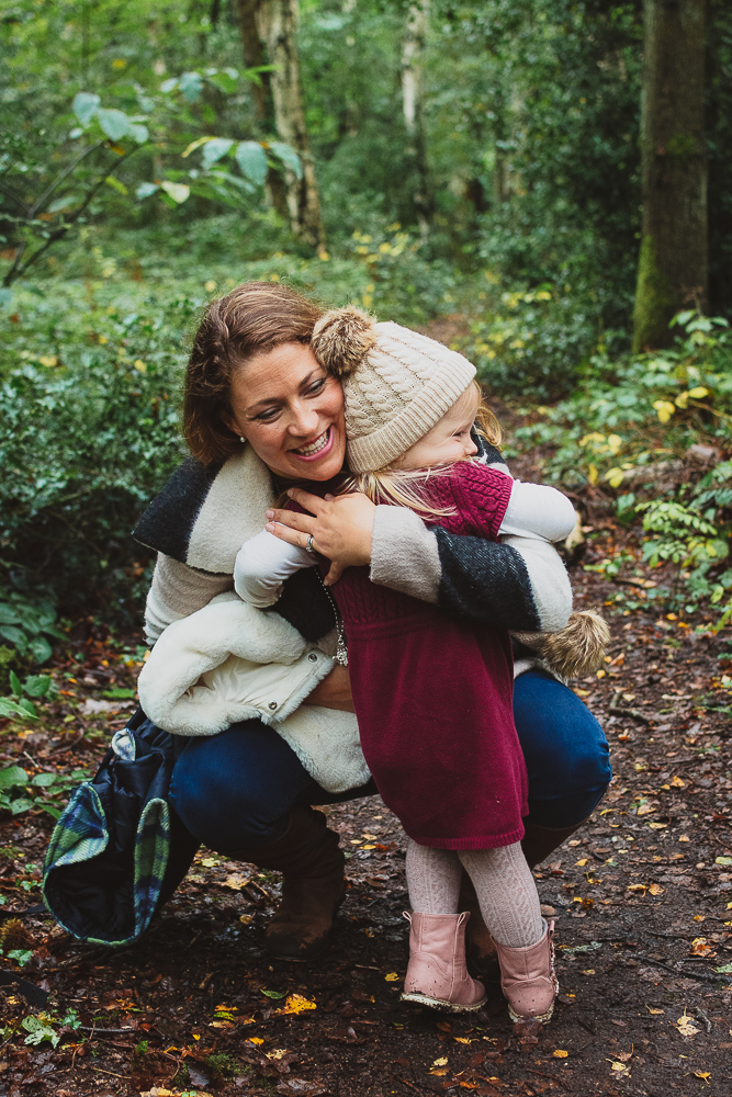 Big cuddles in an outdoor autumn family photoshoot in Reading