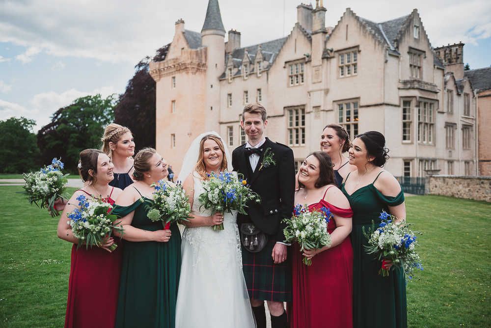 Bride tribe with the bride and groom outside their castle venue