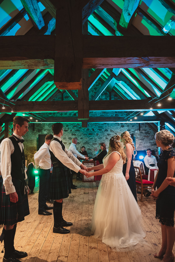 Ceilidh dancing during this Scottish wedding reception
