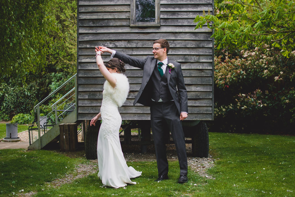 Bride & Groom practicing their first dance outside the shepherds hut at The Tythe Barn in Launton