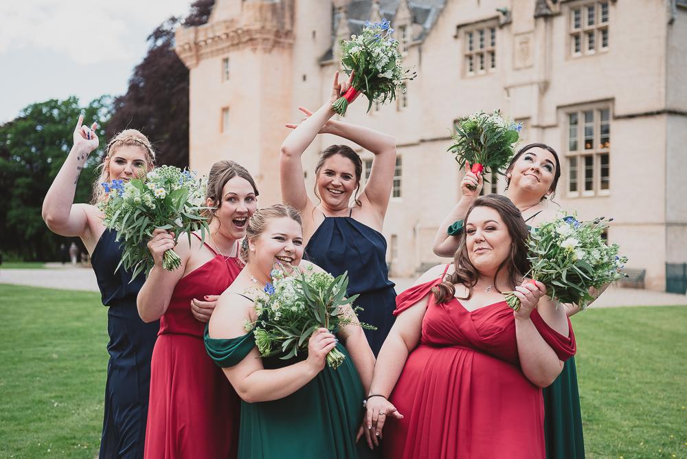 Bride tribe striking a girl band pose
