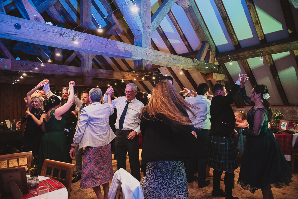 Ceilidh dancing at this wedding reception in Scotland