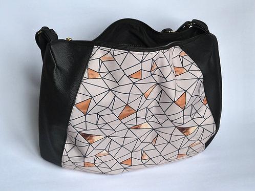 Un CITY BAG DEMI LUNE noir & beige géométrique