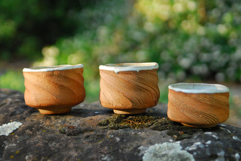 A trio of bowls in red clay